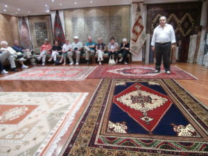 Man showing carpets